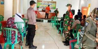 Cegah Antrean Panjang, Bhabinkamtibmas Kecamatan Slahung Gelar Pengamanan Penyaluran BLT DD Tahap I